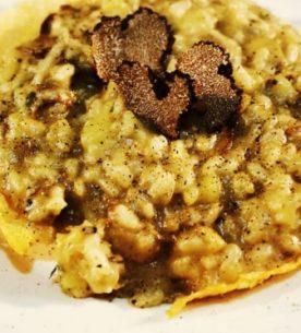 Risotto con funghi porcini, tartufo, patate e provola