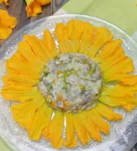Risotto con fiori di zucca e salsiccia